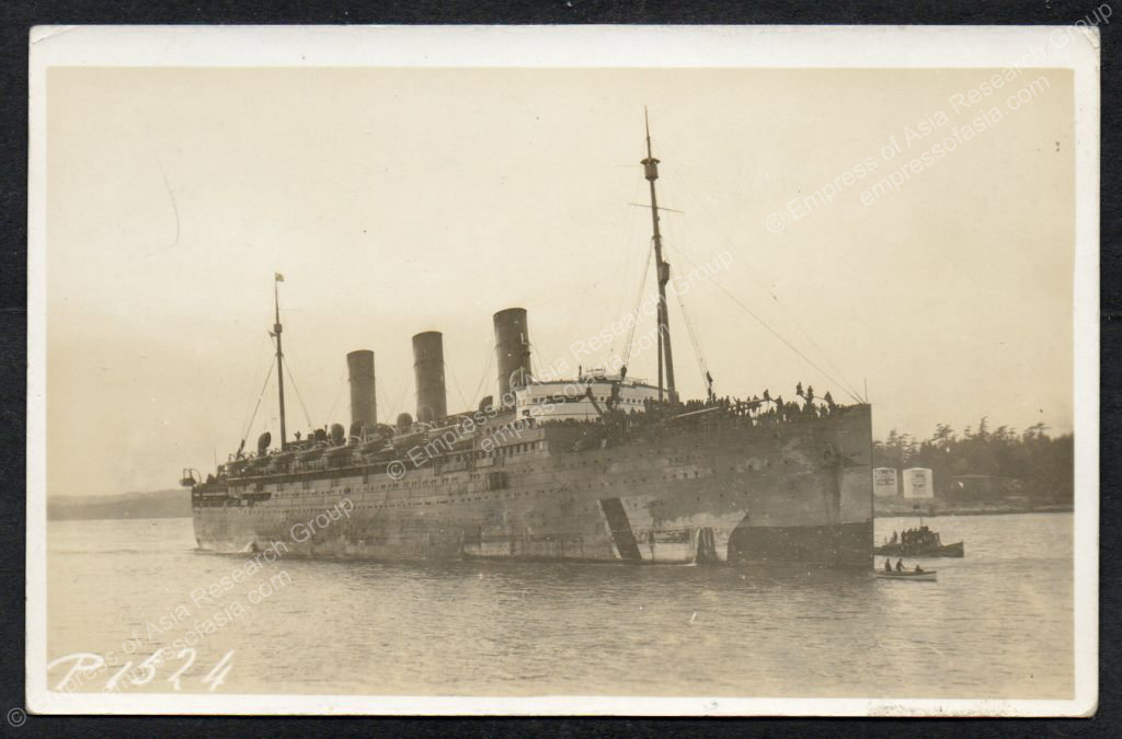 The EMPRESS OF ASIA, returning from Europe with Canadian troops, enters Victoria harbour on 24 January 1919.